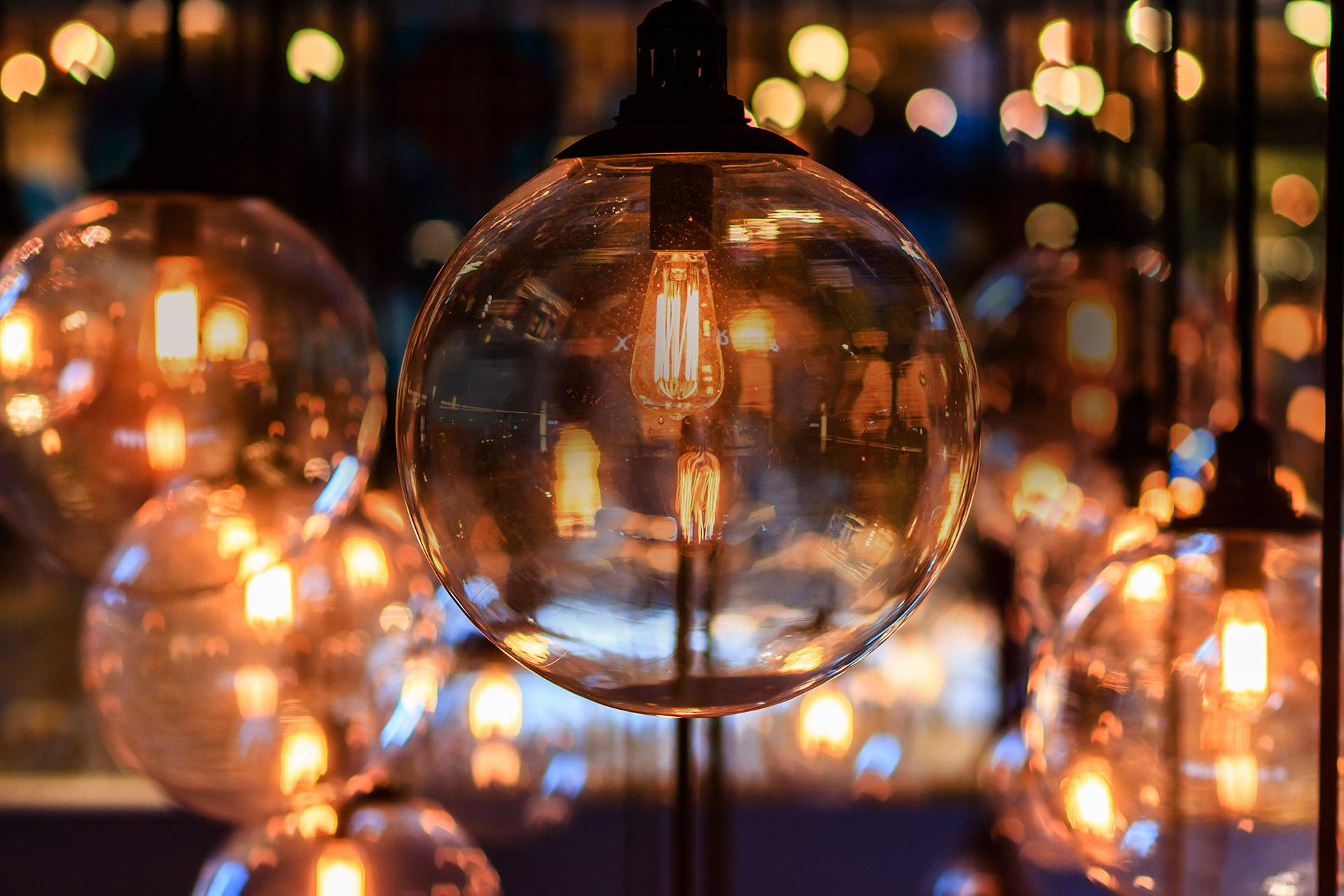 Vintage lightbulb glows orange