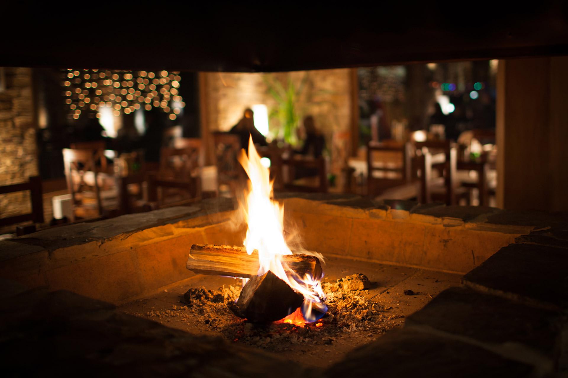 Fireplace blazes on the patio