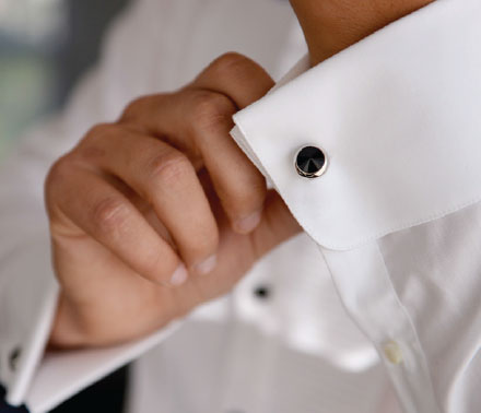 Man adjusting his cufflink.